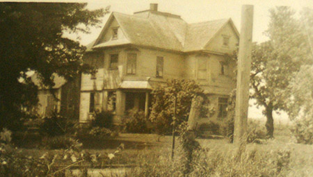 View of house from the railroad tracks, mid-twentieth century