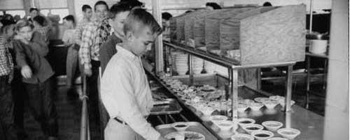 1950's child in school lunch line