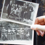 A hand holding 2 old photographs