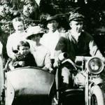 Clarence Mitchell (driving) and Isabell Mitchell (seated) around 1920