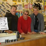 Bill, Mark, and Mike behind the counter.